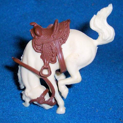 Marx original 60mm, bucking horse with saddle + reins