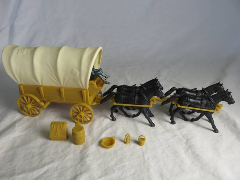 Conestoga Wagon (tan) with 2 different c ream tops plus 4 horses (black)