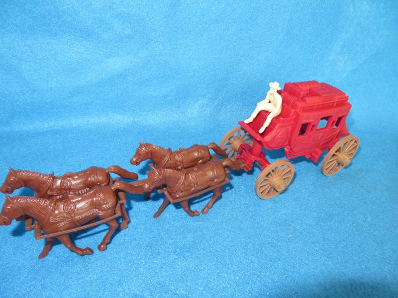 Marx stagecoach with 4 horse hitch and tan driver, red stage, 54mm plastic
